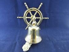 Classic Vintage Reproduction Brass Reception Bell with a Ships Wheel Design.