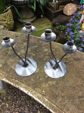 A PAIR OF UNUSUAL METAL TWO ARM CANDLESTICKS #A