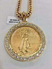 AM. EAGLE 1 OZ GOLD COIN PENDENT W/ DIA. BEZEL APPOX. 6 TDW 14K FRAME 51 GRAM
