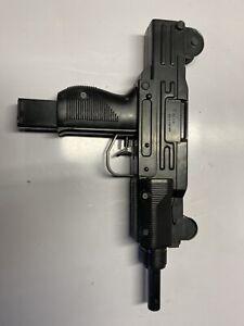 vintage toy Uzi squirt gun works 70s?