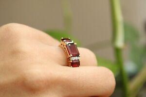 9ct yellow gold three stone emerald cut garnet and round brilliant diamond ring