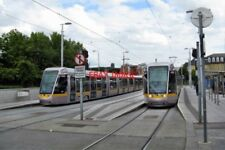 PHOTO  2011 DUBLIN HEUSTON TRAM STOP CAR 3021 ON THE LEFT IS HEADING AWAY FROM T