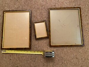 3 brown picture frames