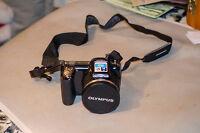 Olympus Stylus SP-810UZ 14.0MP Digital Camera - Black (V103020BU000)