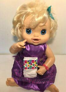 2010 Baby Alive Doll REAL SURPRISES Blonde English Talks Drinks Hasbro Dress