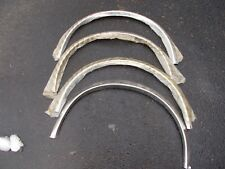 Four Chrome Fender Trim Pieces for a 1982-90 Pontiac Firebird