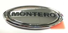 "Genuine Mitsubishi Emblem Badge Logo ""MONTERO""  on LEFT Fender 01 - 06"