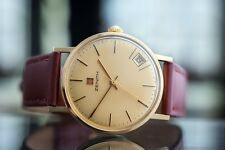 Men's 18K Solid Gold Zenith Date Gold Dial Manual Wind Watch from c. 1975