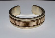 NAVAJO BRUCE MORGAN STERLING SILVER AND 14 K GOLD HEAVY CUFF BRACELET