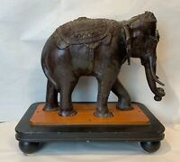 Vintage Asian bronze of an elephant patinated on a wooden base