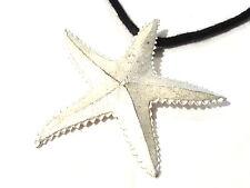 Bijou alliage argenté collier pendentif  étoile de mer ou  astérie Guy Laroche