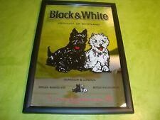 Miroir publicitaire Black&white bon état.