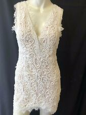 a.Peach size medium white sleeveless lace mini dresss