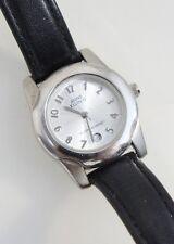 Anne Klein Women's 10-3933 Black Leather Strap Watch Analog Silver Dial Date