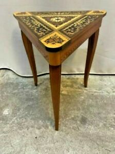 A vintage , wooden , brown, triangle coffee table with decorations