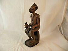 Holzfigur, sitzender Medizinmann, Afrika, 20. Jh.