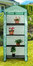 4 tier mini portable greenhouse on wheels,metal frame,PE cover, Grow house.