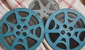 16mm FEATURE FILM, THREE REELS, BILLY THE KID, ROBERT TAYLOR, BW AND SOUND.