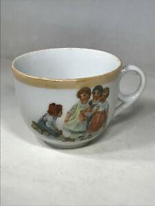 Vintage Tea Cup w/ Four Children