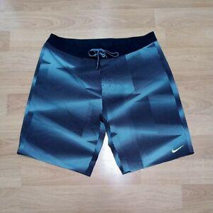 NIKE Men's Size 38 Teal Geometric & Stripe Print Board Shorts Swim Yellow Swoosh