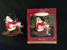 "1997 Hallmark Ornament ""Coca-Cola"" Santa Taking a Break drinking bottle of Coke"