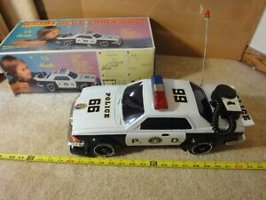 Vintage battery operated lights, sound Bump N Go Mercedes Benz-280CE Police Car.