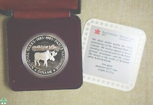 1985 CANADA 100TH ANNIVERSARY SILVER DOLLAR WITH ORIGINAL BOX AND PAPERS