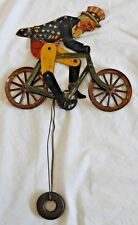 Antique Uncle Sam on Bicycle Tin Litho String Balance Toy