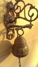 antigua campana llamador en bronce eclesial artesanal con  grabados