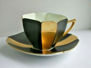 A Shelley QUEEN ANNE  cup & saucer - JET BLACK & GOLD panels   .