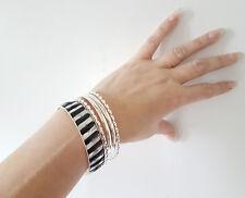 Pretty 5 piece silver tone & black diamante effect set of bangles - bracelets