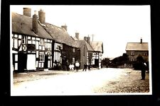 Malpas Village - Street Scene - real photographic postcard