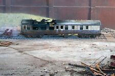 OO gauge abandoned fire damaged coach, heavily rusted and weathered