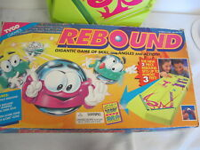 TYCO REBOUND GAME WITH 7 PUCKS VINTAGE 1994