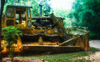 Framed Print - JCB Bulldozer Rusting Away in the Jungle (Picture Poster Art)