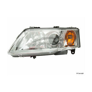 One New TYC Headlight Assembly Left 20669400 for Saab 9-3