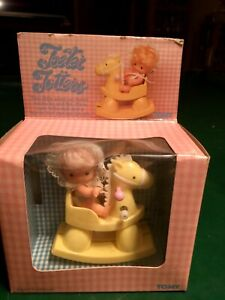 Vintage 1981 TOMY Teeter Totters Wind-up Toy Baby Doll on Rocking Horse