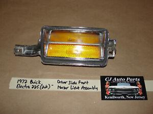 72 Buick Electra 225 LEFT DRIVER SIDE FRONT MARKER PARK LIGHT LENS BEZEL TRIM