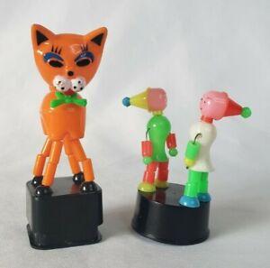 x2 Vintage Plastic Collapsible Thumb Push Button Puppet Toy Boxers Orange Cat