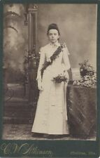 WOMAN STANDING WITH FLORAL DISPLAY CABINET CARD, MOLINE, ILLS.