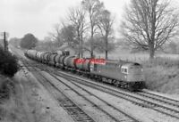 PHOTO  CLASS 33 LOCO ON OIL TANKS AT  FAIRWOOD JNC  20-09-77