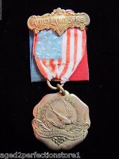 Antique 1912 Cafe Martin New York Souvenir Medallion Flag Ribbon ornate d&c