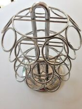 Spinning chrome finish carousel for Keurig K cup storage holds 27 capsules spins