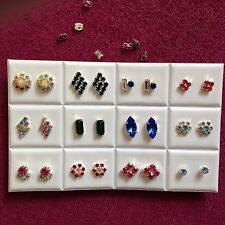 JOB LOT-12pairs of different shapes colour diamonte stud earrings.Silver plated.