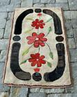Tri-flower motif Hooked Rug, early 20th c