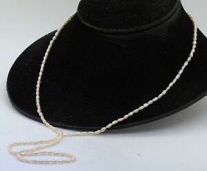 "Elegant high fashion 6 X 3mm rice pearl 32"" long strand necklace"