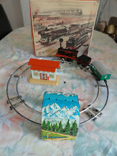 vintage clock work toy tin train west germany with box and key