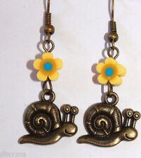 Gardeners earrings - bronze snail on yellow flower Gardening Jewellery (F1)