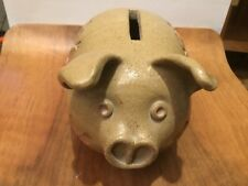A rare hand made pottery piggy bank with floral decoration and protruding ears