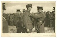 Antique WW1 military postcard Decorating a Canadian on the Field of Battle
